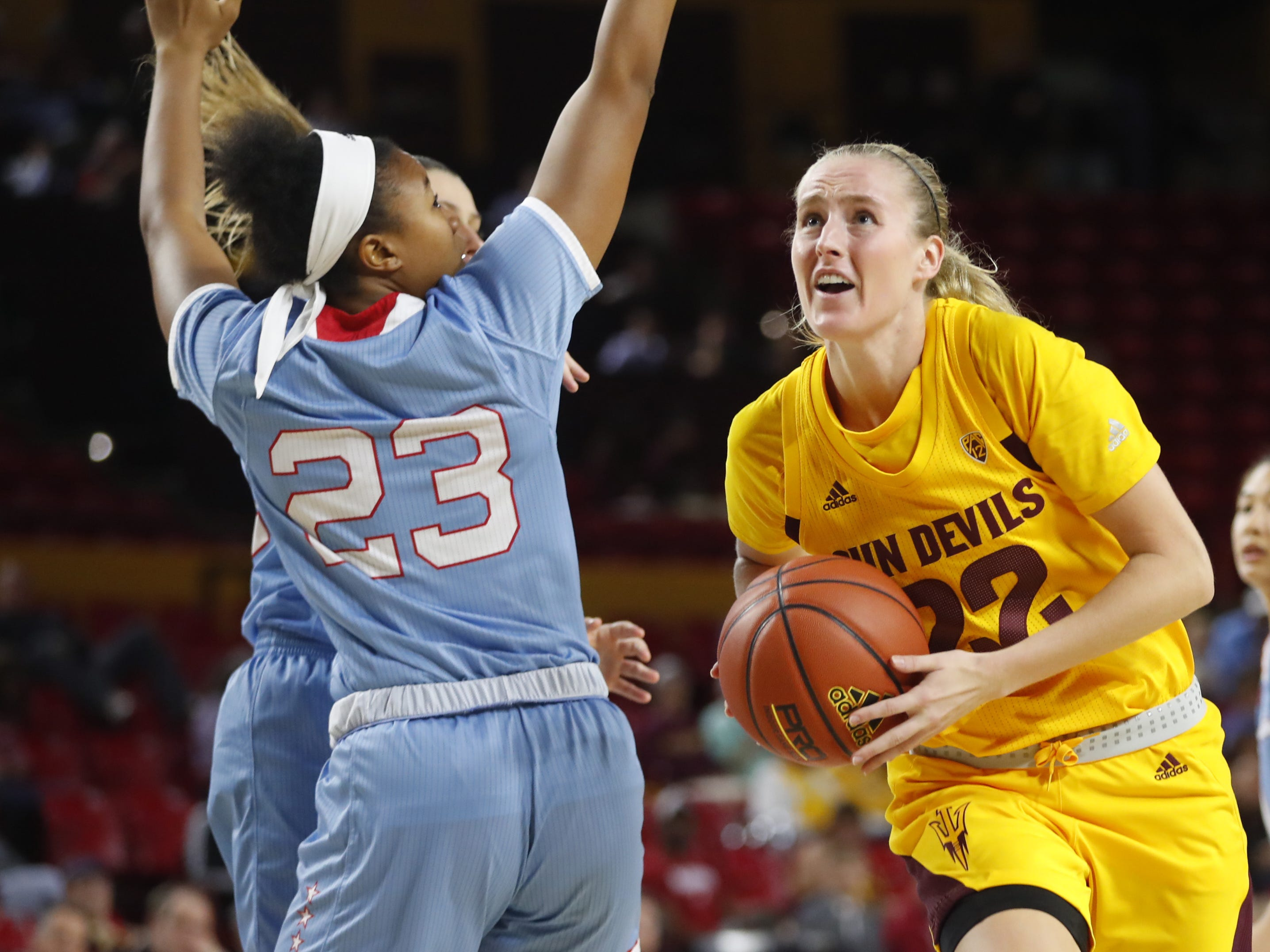 ASU's Courtney Ekmark (22) drive to the hoop against Louisiana Tech's Reauna Cleaver (23) during the second half at Wells Fargo Arena in Tempe, Ariz. on November 30, 2018.