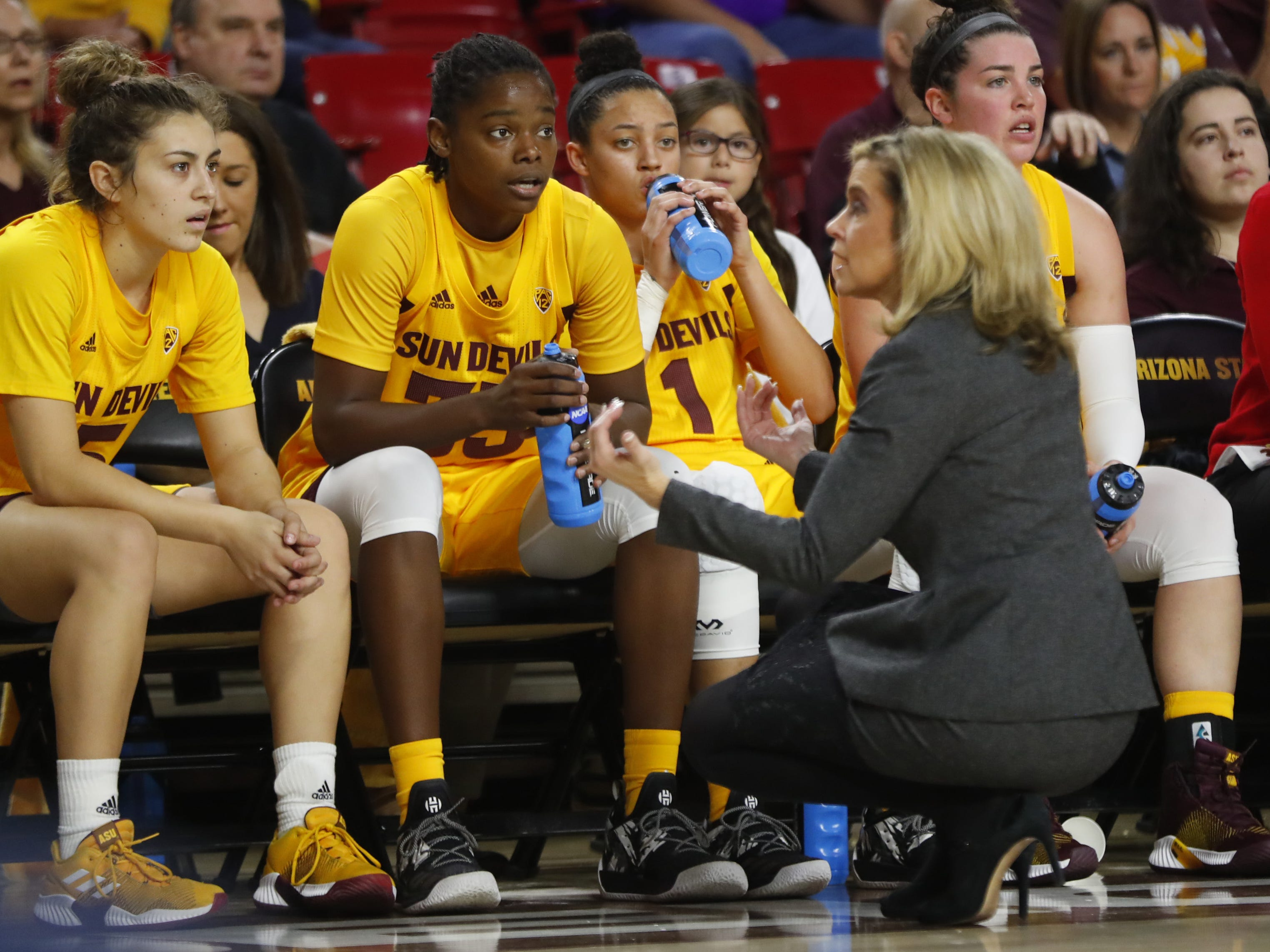 ASU's head coach Charli Turner Thorne talks to her team on the bench during the second half against LA Tech at Wells Fargo Arena in Tempe, Ariz. on November 30, 2018.