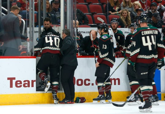 Coyotes' Michael Grabner (40) is helped off the ice after a Blues high-sticking during the first period at Gila River Arena in Glendale, Ariz. on December 1, 2018.