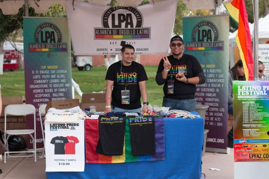 Eric Villezcas Neri and Tony DiMaggio worked at the Latino Pride Alliance booth. The group helped organize the Latino Pride Festival.