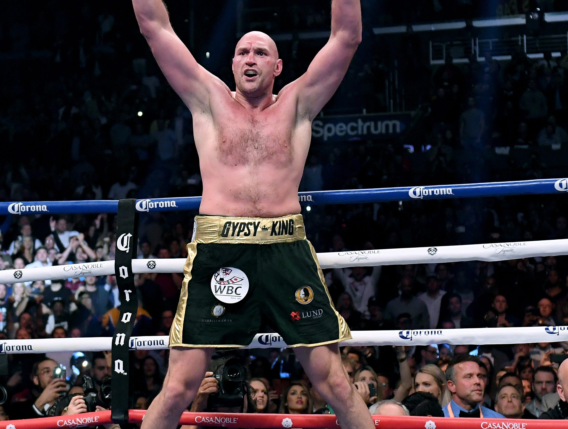 Tyson Fury celebrates at the end of the 12th-round of his WBC Heavyweight tile fight against Deontay Wilder on Dec. 1 at Staples Center.