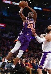 Dec 2, 2018; Los Angeles, CA, USA; Phoenix Suns forward Josh Jackson (20) shoots over Los Angeles Lakers center Tyson Chandler (5) during the first quarter at Staples Center. Mandatory Credit: Robert Hanashiro-USA TODAY Sports