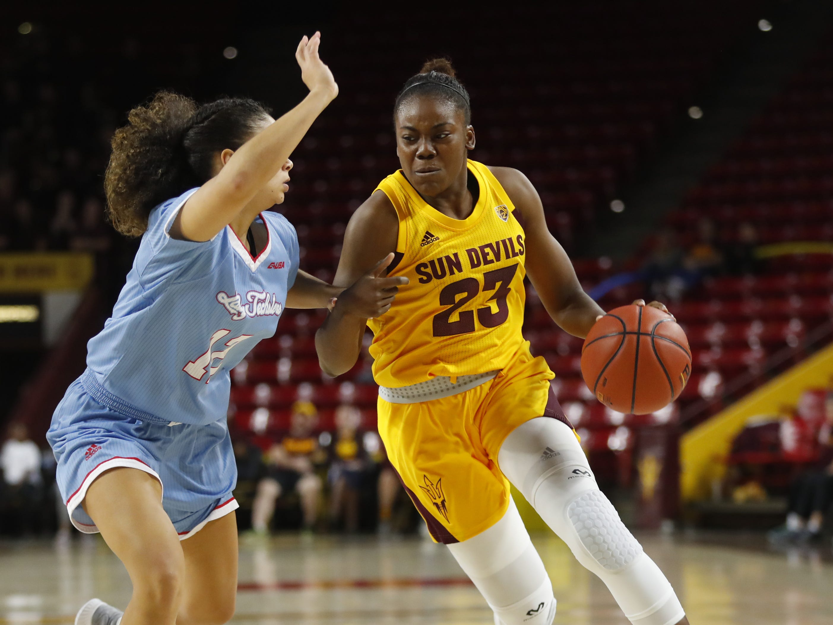ASU's Iris Mbulito (23) drives against Louisiana Tech's Daria McCutcheon (12) during the second half at Wells Fargo Arena in Tempe, Ariz. on November 30, 2018.