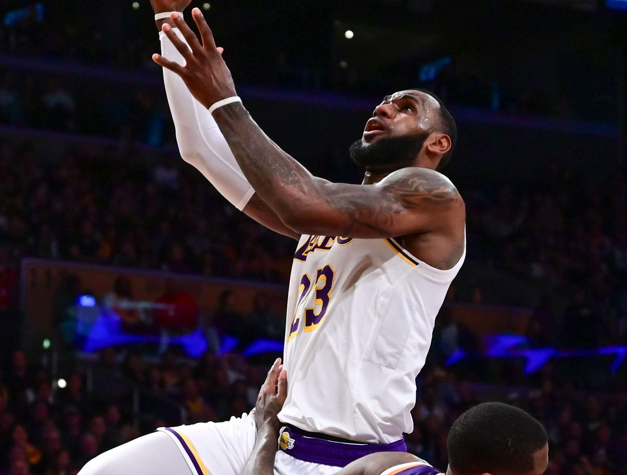 Dec 2, 2018; Los Angeles, CA, USA; Los Angeles Lakers forward LeBron James (23) scores past Phoenix Suns guard Jamal Crawford (11) during the third quarter at Staples Center. Mandatory Credit: Robert Hanashiro-USA TODAY Sports