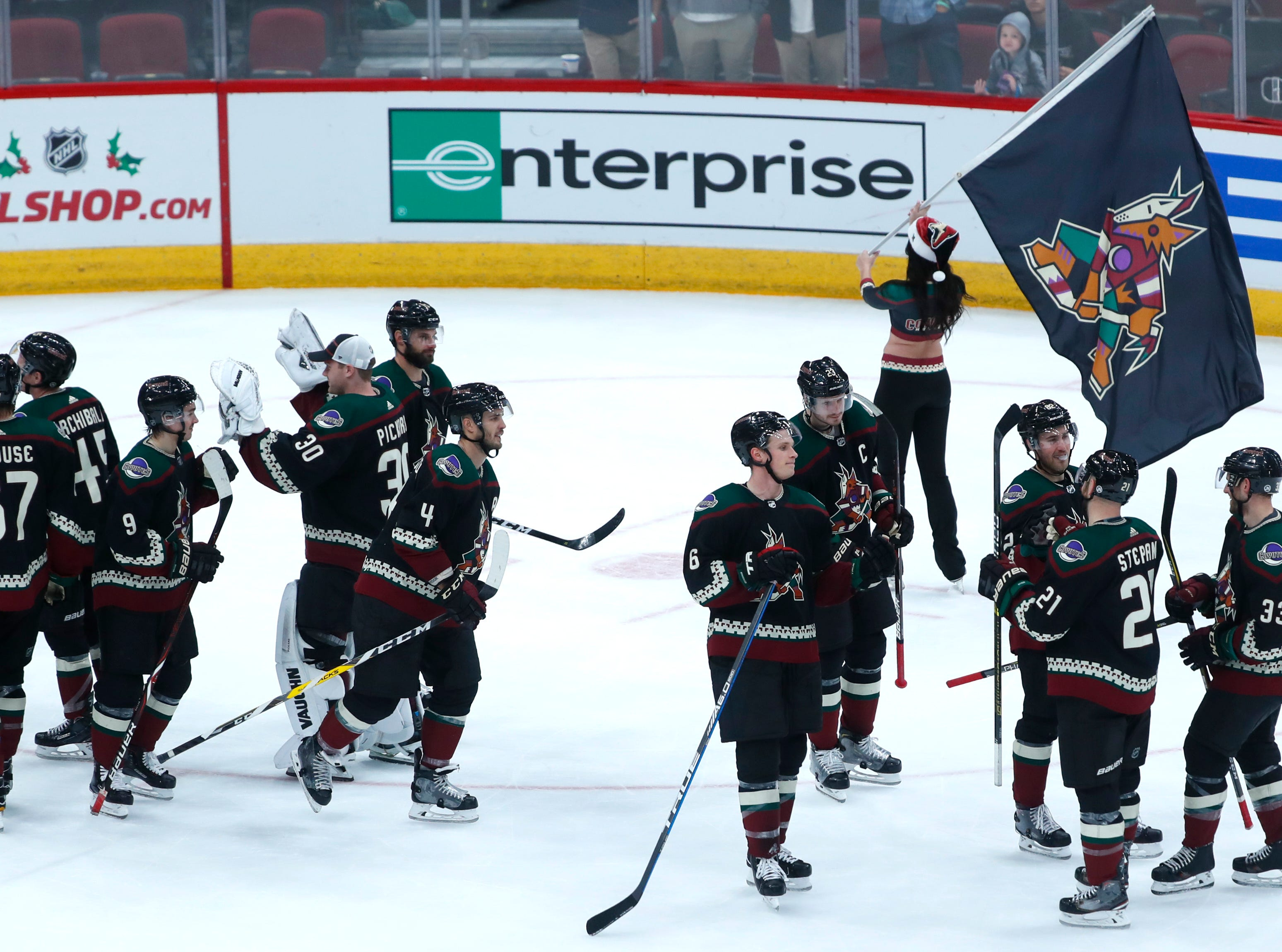 The Coyotes celebrate after the team won 6-1 over the Blues at Gila River Arena in Glendale, Ariz. on December 1, 2018.