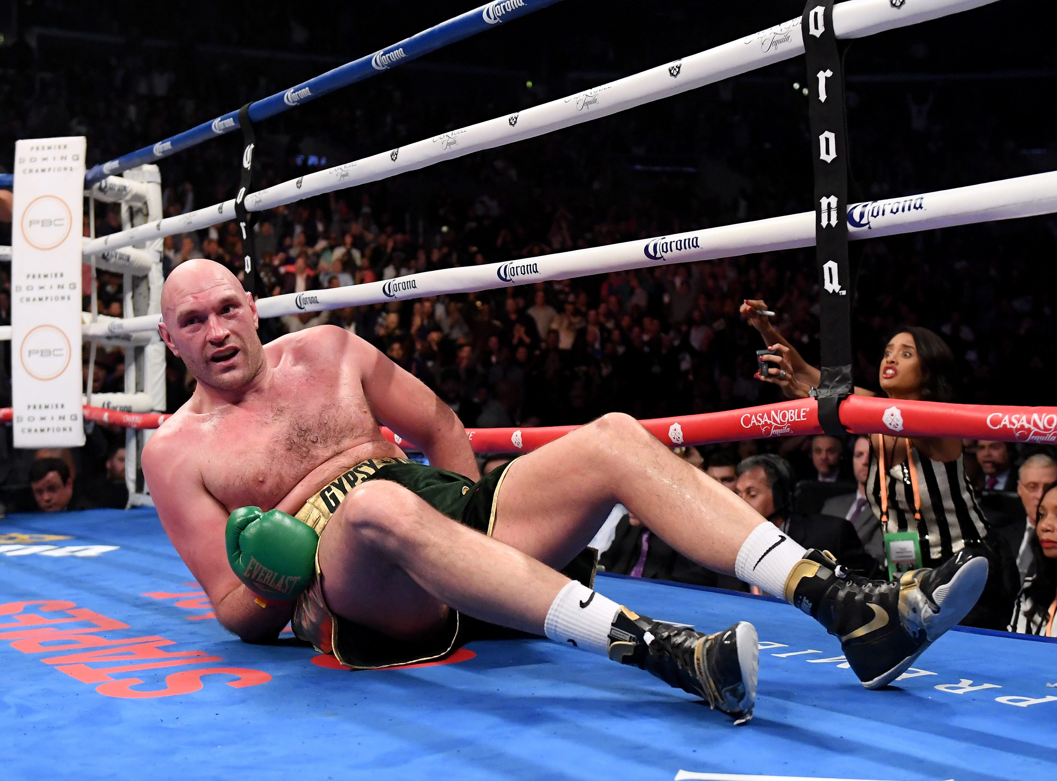 Tyson Fury reacts to getting knocked down during the ninth round of his heavyweight title fight with Deontay Wilder on Dec. 1 at Staples Center.