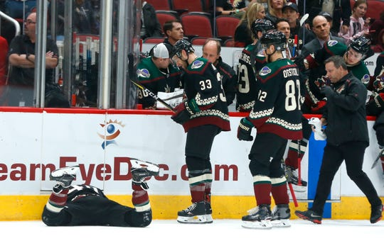 Coyotes' Michael Grabner (40) lays on the ice after a Blues high-sticking during the first period at Gila River Arena in Glendale, Ariz. on December 1, 2018.