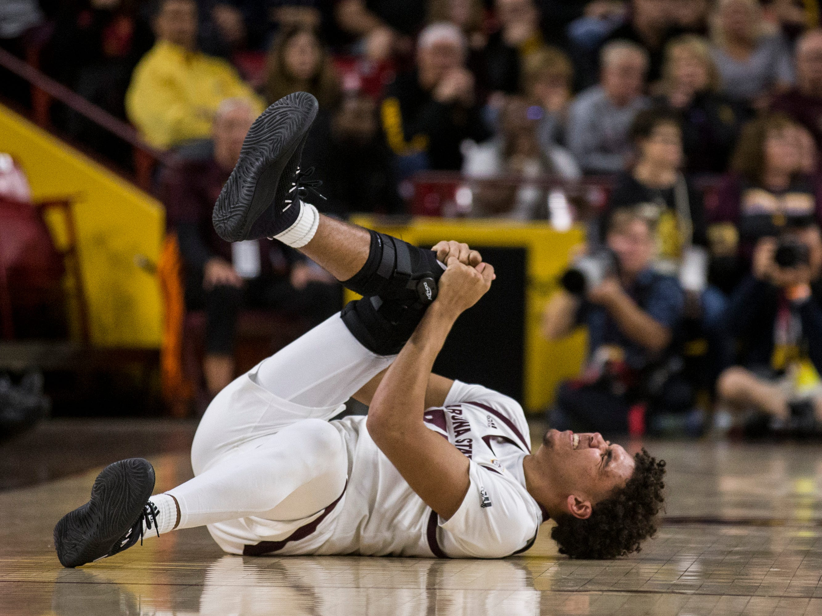 Arizona State's Taeshon Cherry grimaces in pain in the first half against Texas Southern on Saturday, Dec. 1, 2018, at Wells Fargo Arena in Tempe, Ariz.