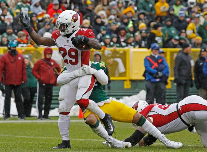 Arizona Cardinals running back Chase Edmonds (29) rushes for a touchdown during the first half of an NFL football game against the Green Bay Packers Sunday, Dec. 2, 2018, in Green Bay, Wis. (AP Photo/Jeffrey Phelps)
