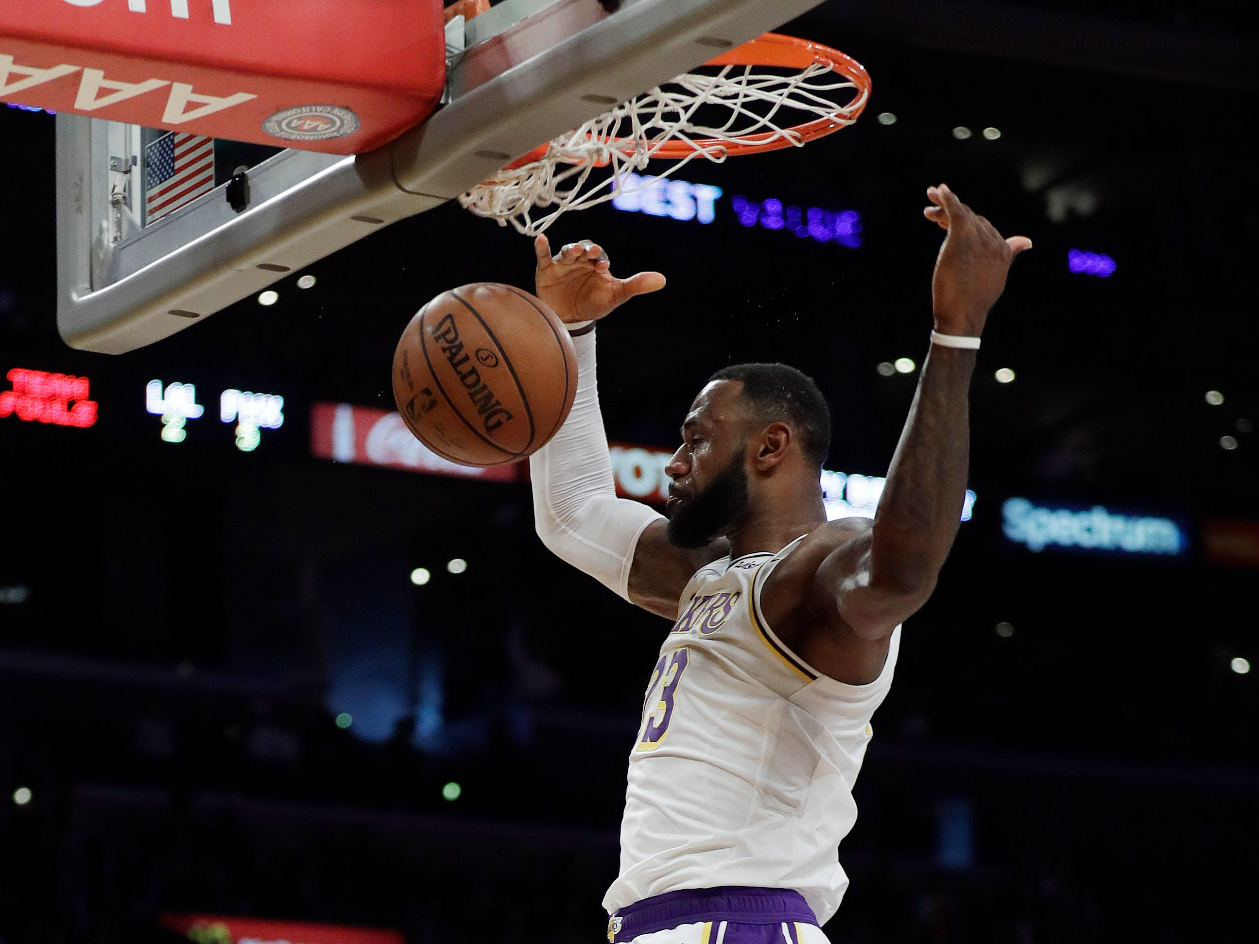 Los Angeles Lakers' LeBron James scores on a breakaway dunk against the Phoenix Suns during the second half of an NBA basketball game Sunday, Dec. 2, 2018, in Los Angeles. (AP Photo/Marcio Jose Sanchez)