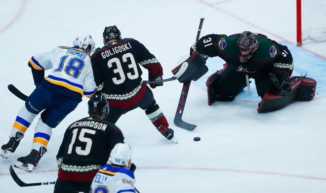 Coyotes' Adin Hill (31) makes a save on a shot from Blues' Robert Thomas (18) during the second period at Gila River Arena in Glendale, Ariz. on December 1, 2018.
