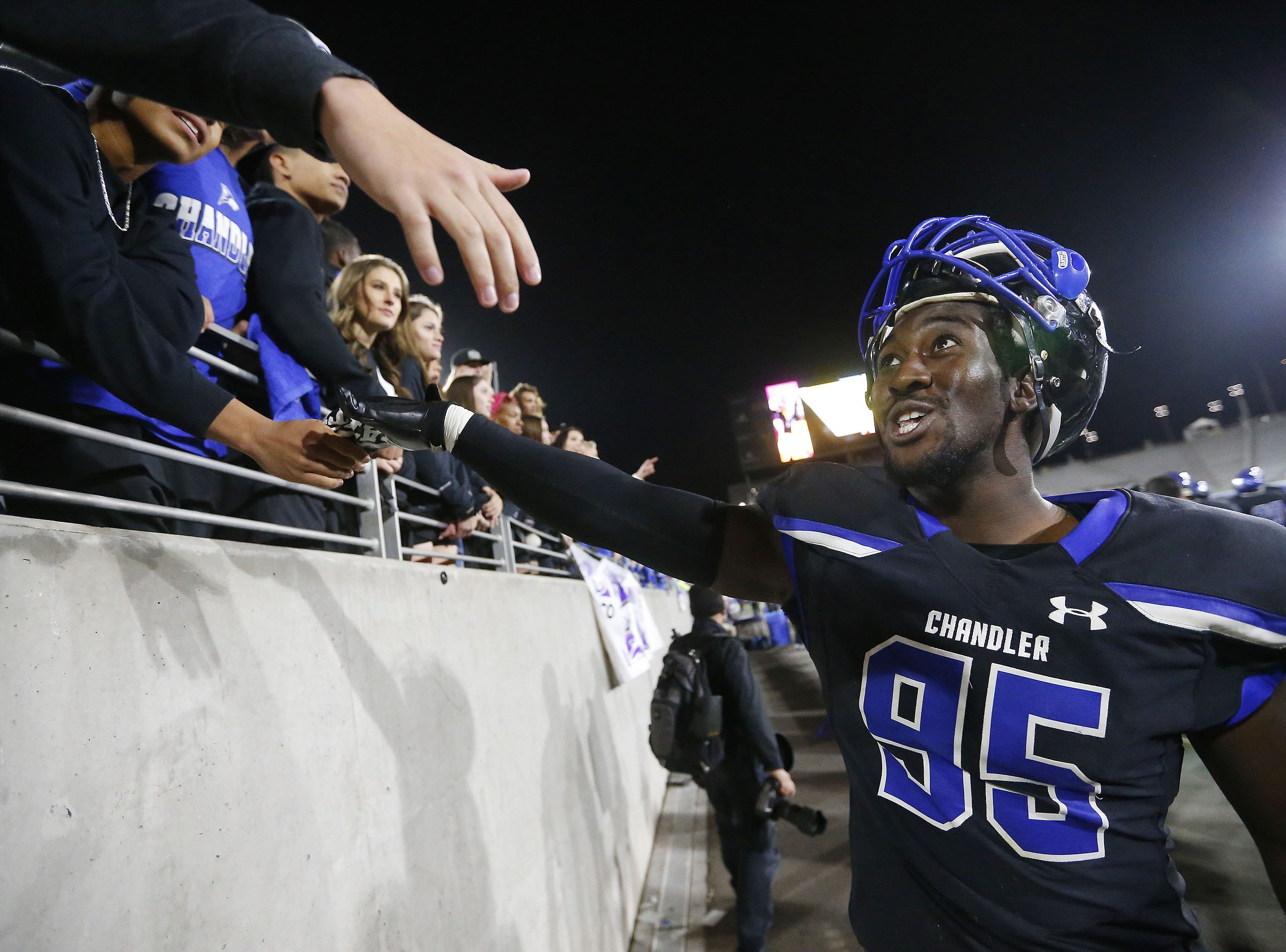 Chandler defensive lineman Miles McNair (95) celebrates with fans during their 65-28 win against Perry in the 6A state football championship game at Sun Devil Stadium December 1, 2018. #azhsfb