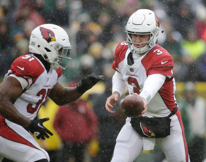 Cardinals quarterback Josh Rosen hands the ball off during a game against the Packers on Dec. 2 at Lambeau Field.