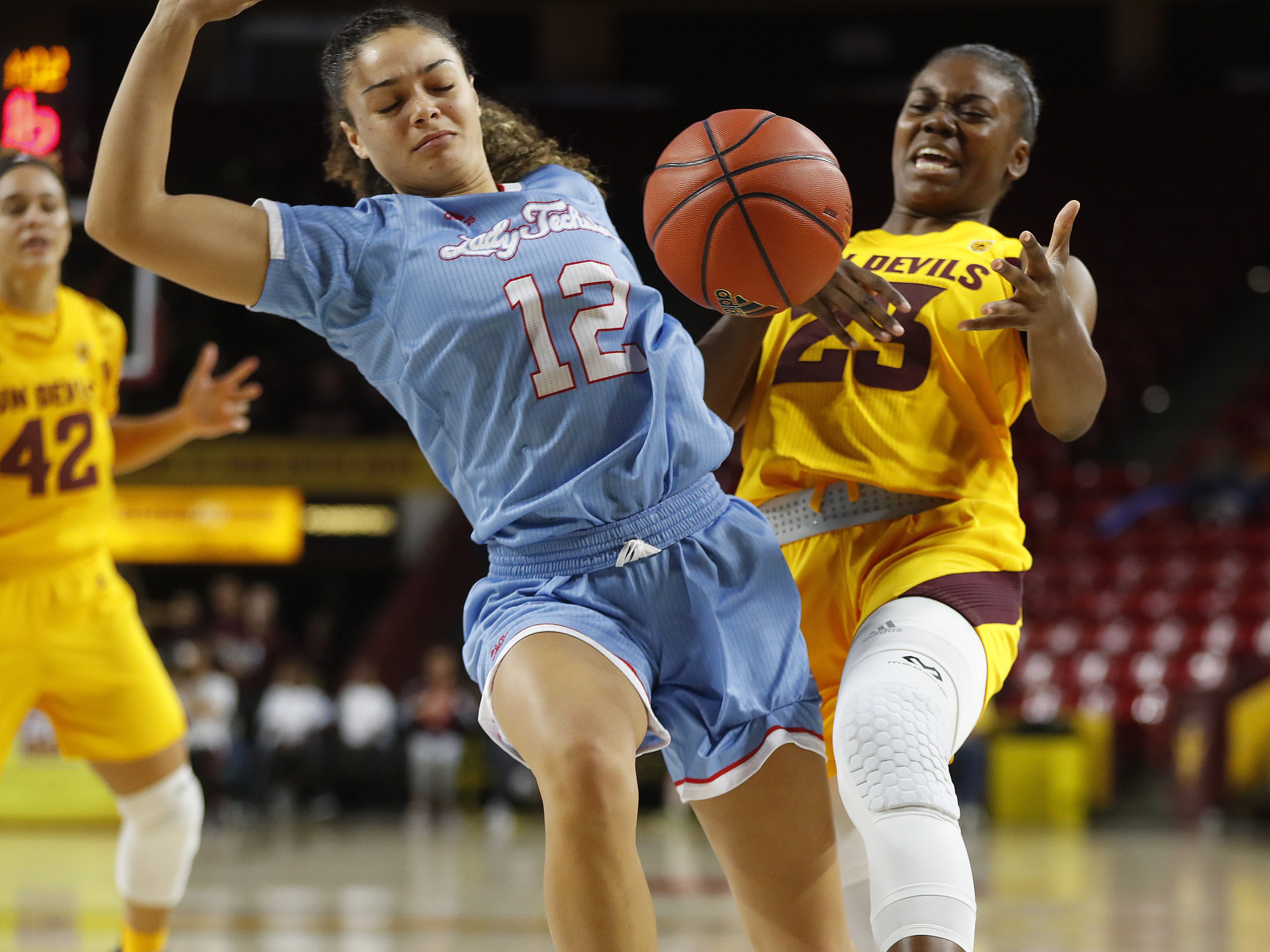 ASU's Iris Mbulito (23) draws a foul on Louisiana Tech's Daria McCutcheon (12) during the second half at Wells Fargo Arena in Tempe, Ariz. on November 30, 2018.