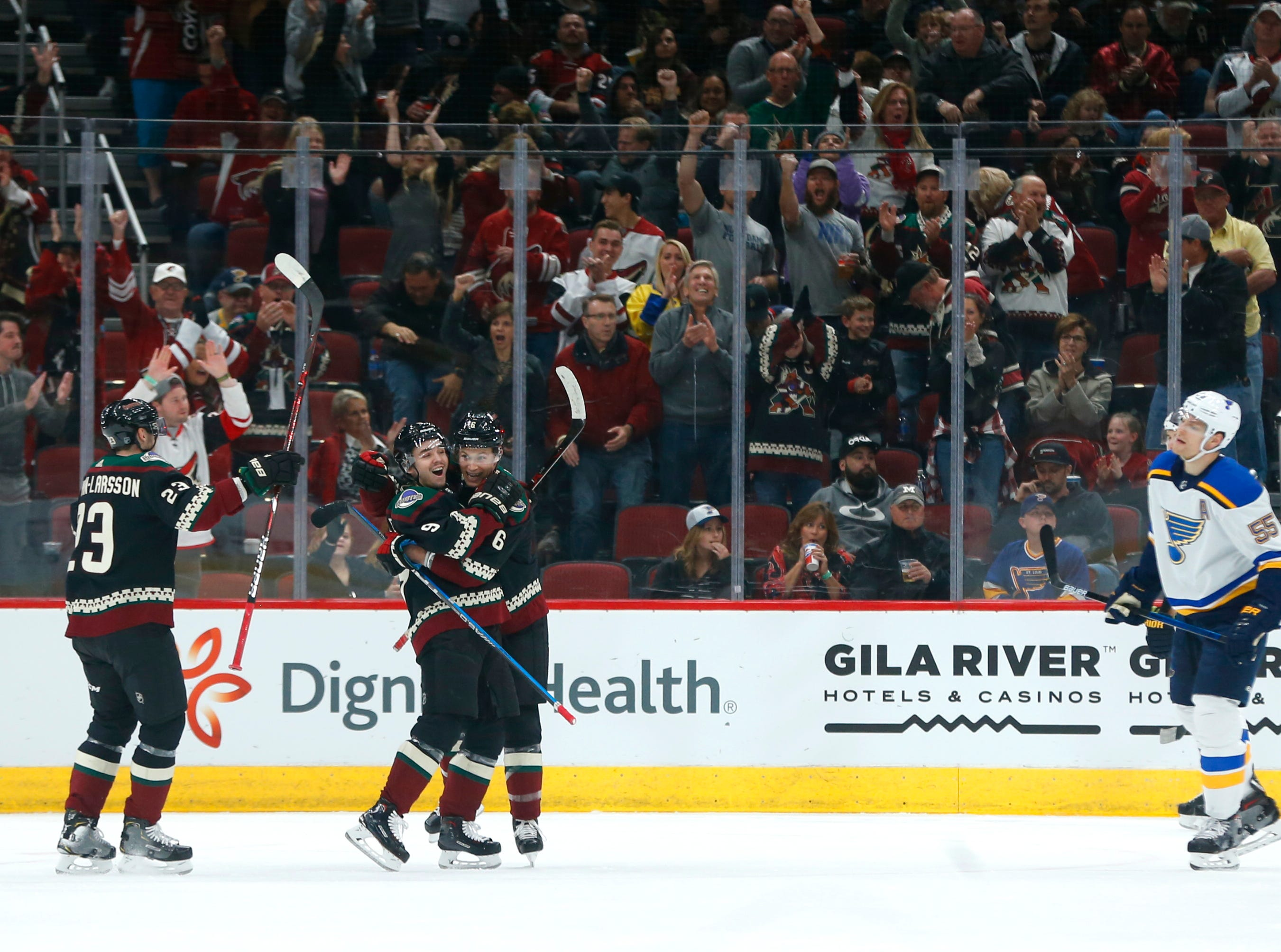 Coyotes' Oliver Ekman-Larsson (23) and Clayton Keller (9) celebrate with Jacob Chychrun (6) after his goal against the Blues during the first period at Gila River Arena in Glendale, Ariz. on December 1, 2018.