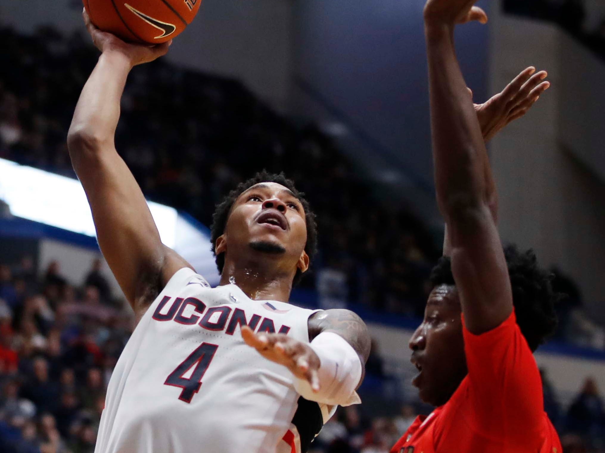 Dec 2, 2018: Connecticut Huskies guard Jalen Adams (4) shoots against Arizona Wildcats guard Dylan Smith (3) in the first half at XL Center.