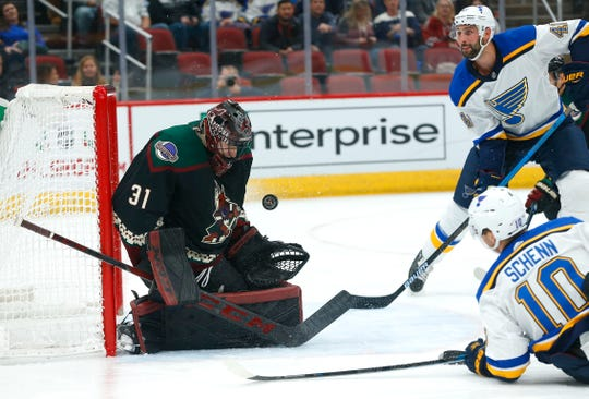 Coyotes' goalie Adin Hill (31) makes a save against Blues' Brayden Schenn (10) during the first period at Gila River Arena in Glendale, Ariz. on December 1, 2018.