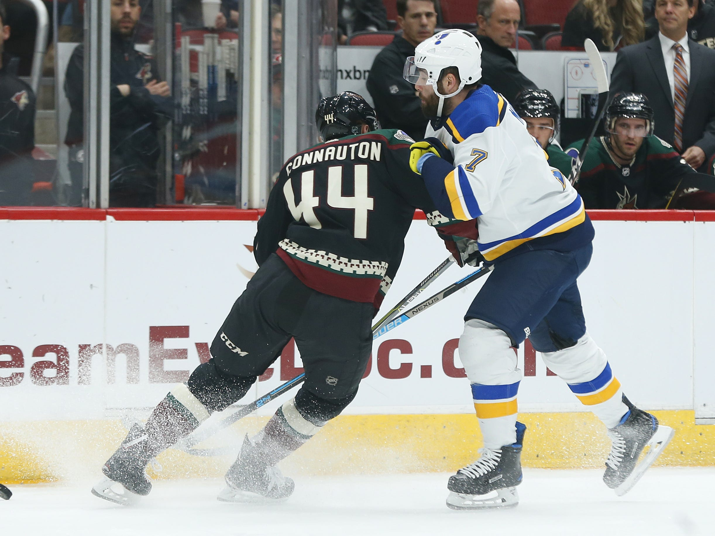 Coyotes' Kevin Connauton (44) hits Blues' Pat Maroon (7) during the first period at Gila River Arena in Glendale, Ariz. on December 1, 2018.
