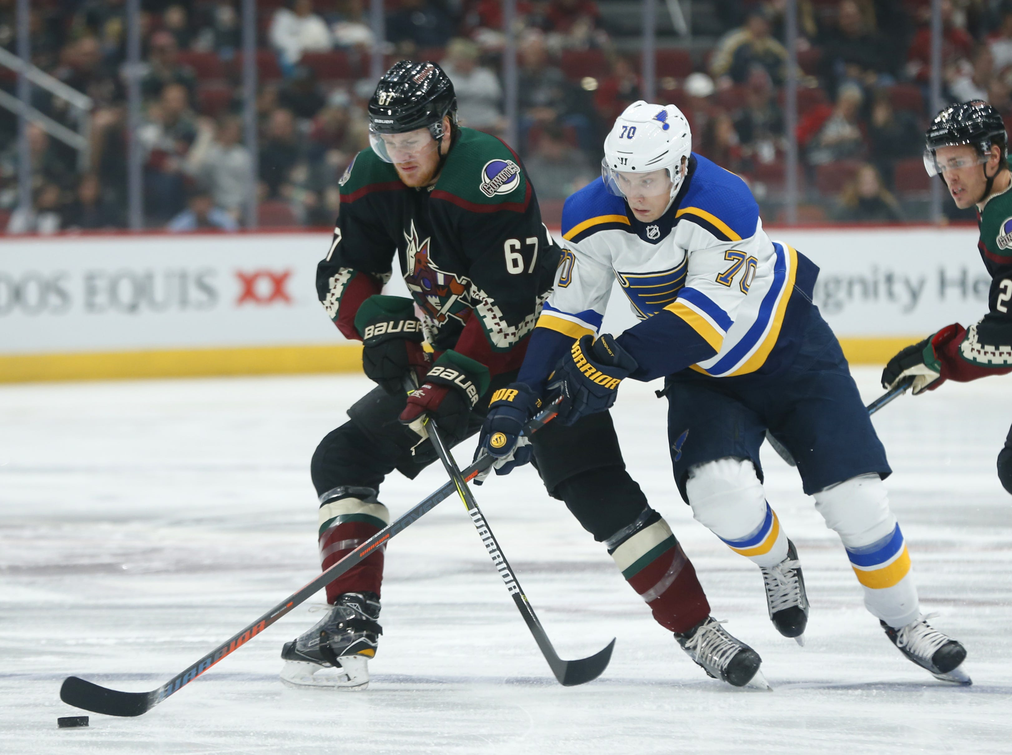 Coyotes' Lawson Crouse (67) and Blues' Oskar Sundqvist (70) during the first period at Gila River Arena in Glendale, Ariz. on December 1, 2018.