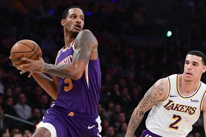 Suns forward Trevor Ariza looks to pass as he drives past Lakers guard Lonzo Ball during the first quarter of a game Dec. 2 at Staples Center.