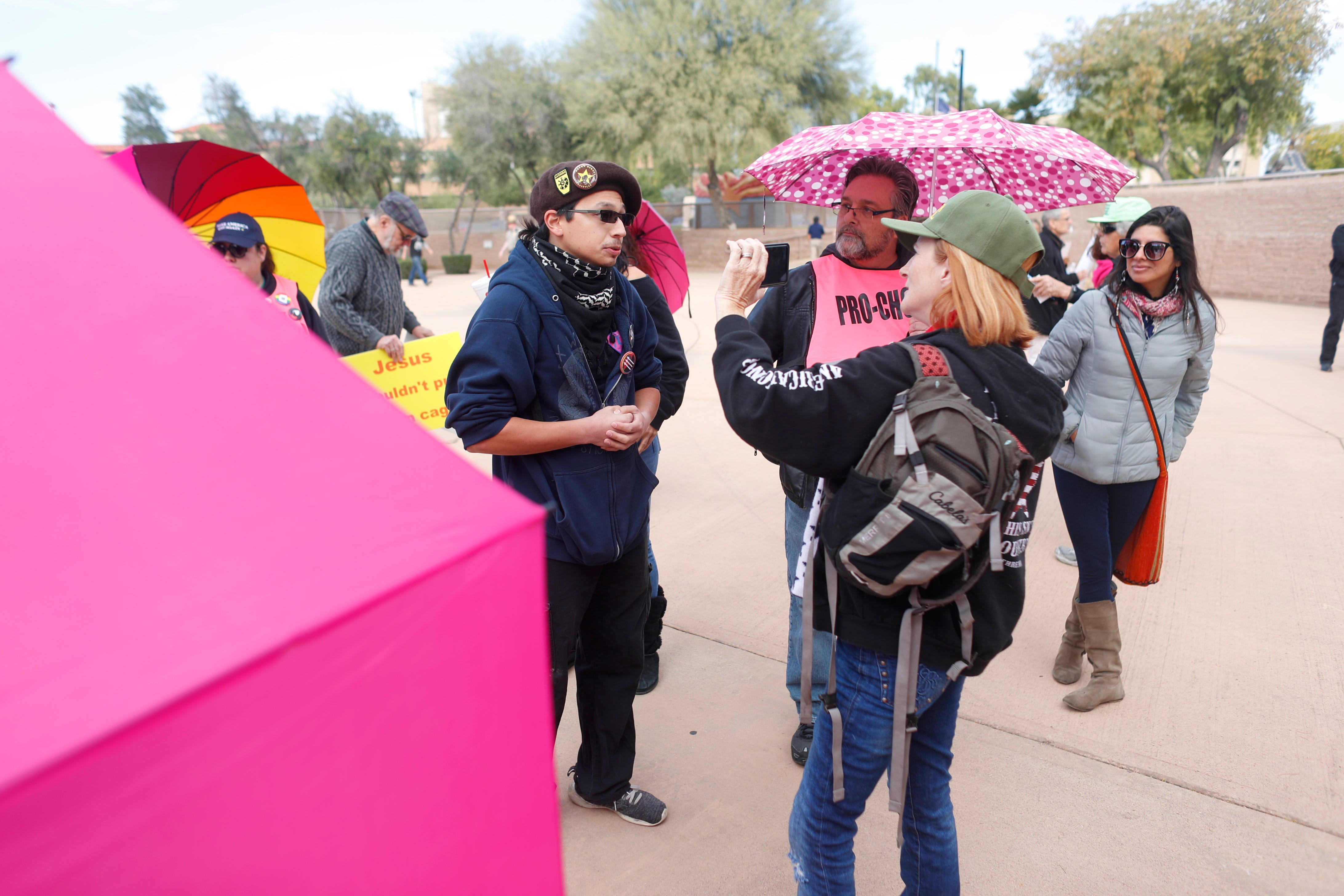 Dillon Williams (left) argues with Lesa Antone of Patriot Movement AZ during a rally at Wesley Bolin Memorial Plaza on Dec. 2, 2018.