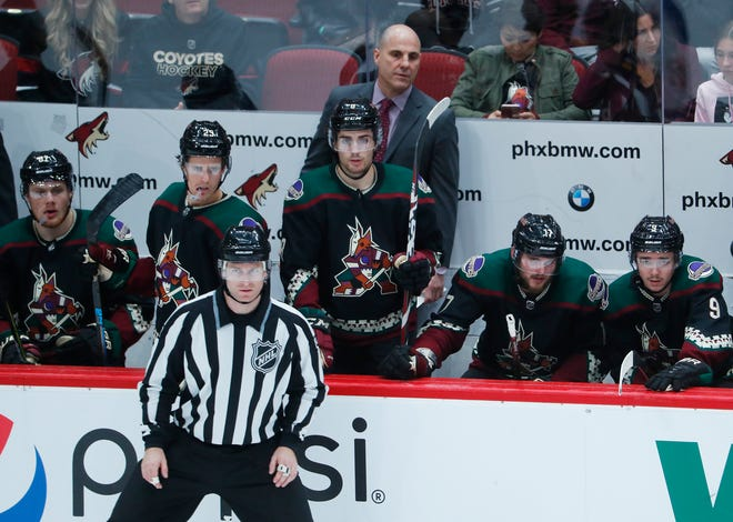 Coyotes' head coach Rick Tocchet watches his team play the Blues during the second period at Gila River Arena in Glendale, Ariz. on December 1, 2018.