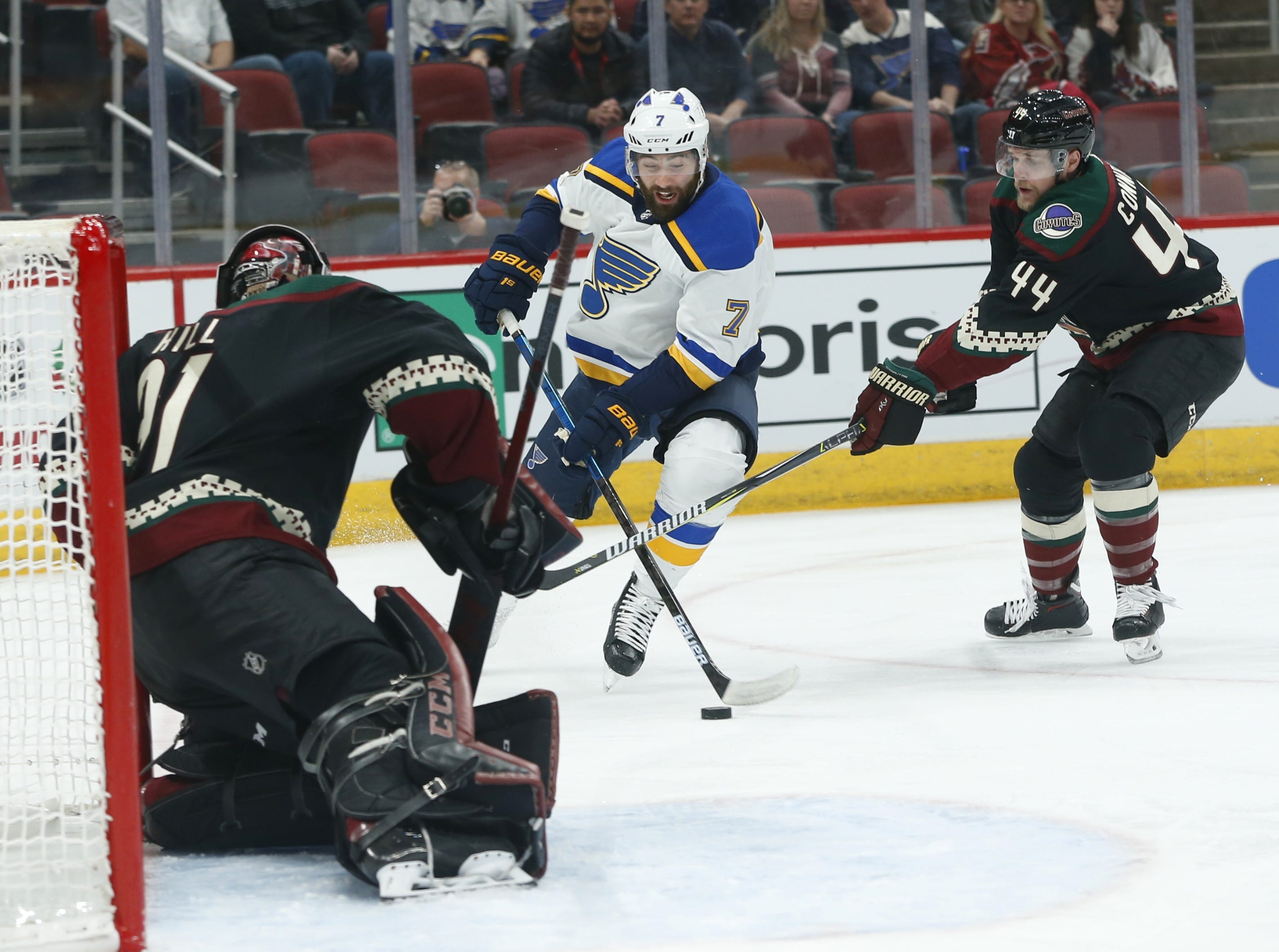 Blues' Pat Maroon (7) shoots against Coyotes' goalie Adin Hill (31) during the first period at Gila River Arena in Glendale, Ariz. on December 1, 2018.