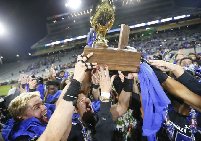 Chandler players celebrate their 65-28 win against Perry in the 6A state football championship game at Sun Devil Stadium December 1, 2018. #azhsfb