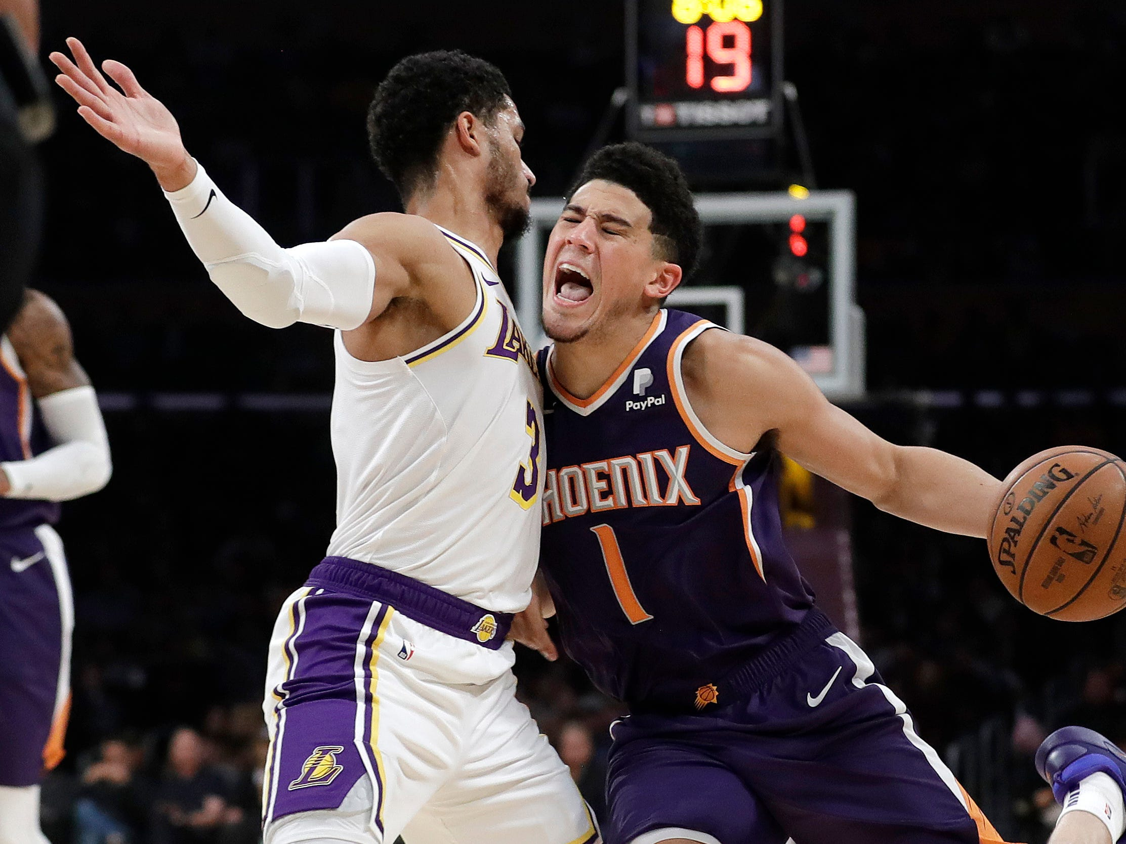 Phoenix Suns' Devin Booker (1) is defended by Los Angeles Lakers' Josh Hart (3) during the first half of an NBA basketball game Sunday, Dec. 2, 2018, in Los Angeles. (AP Photo/Marcio Jose Sanchez)