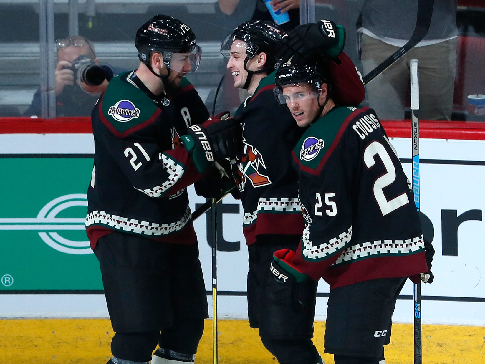 Coyotes' Clayton Keller (center), Derek Stepan (21) and Nick Cousins (25) celebrate a goal against the Blues during the second period at Gila River Arena in Glendale, Ariz. on December 1, 2018.