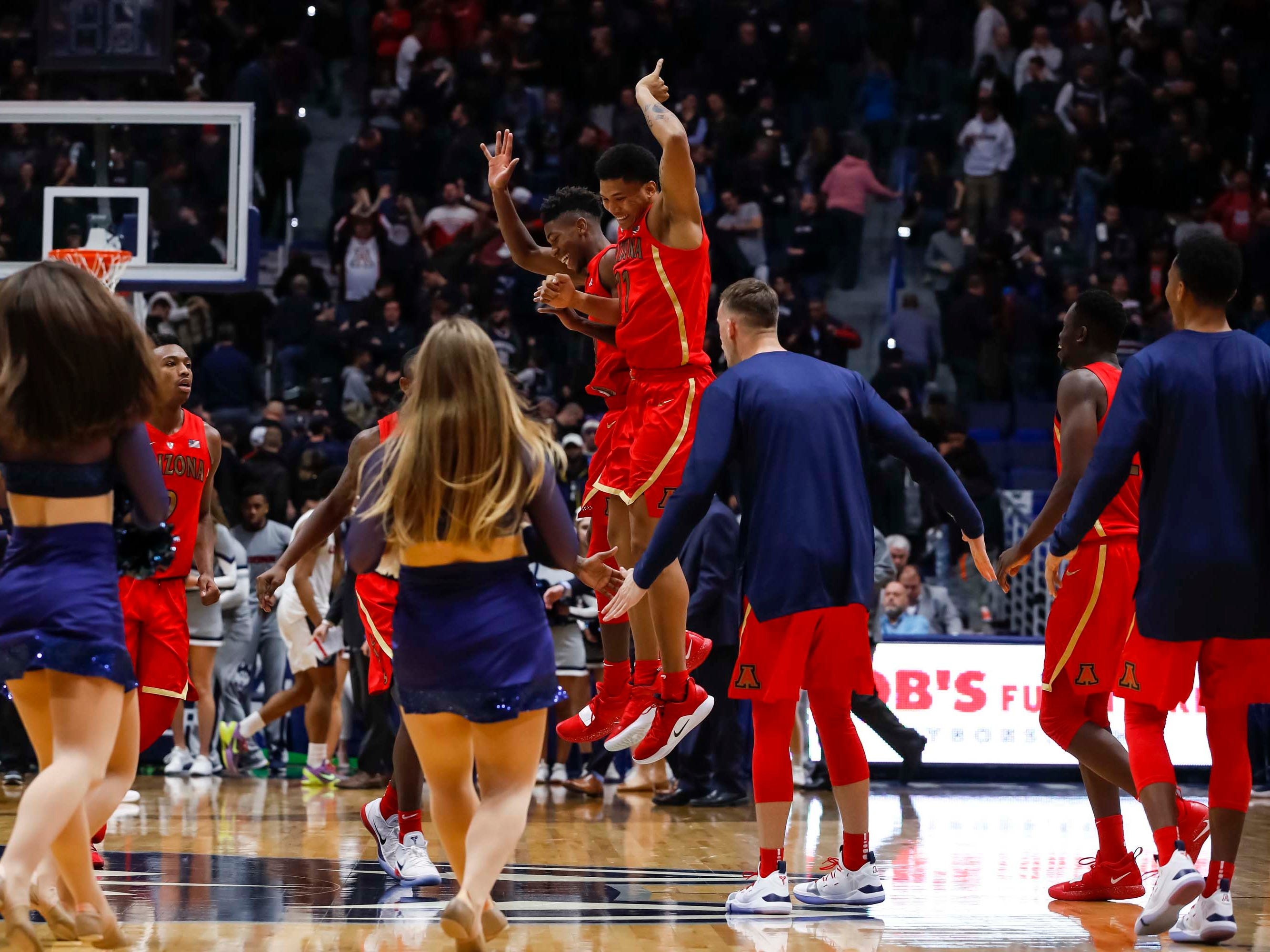 Dec 2, 2018; Storrs, CT, USA; Arizona Wildcats guard Brandon Randolph (5) and Arizona Wildcats forward Ira Lee (11) react after defeating the Connecticut Huskies at XL Center. Arizona defeated UConn 76-72. Mandatory Credit: David Butler II-USA TODAY Sports