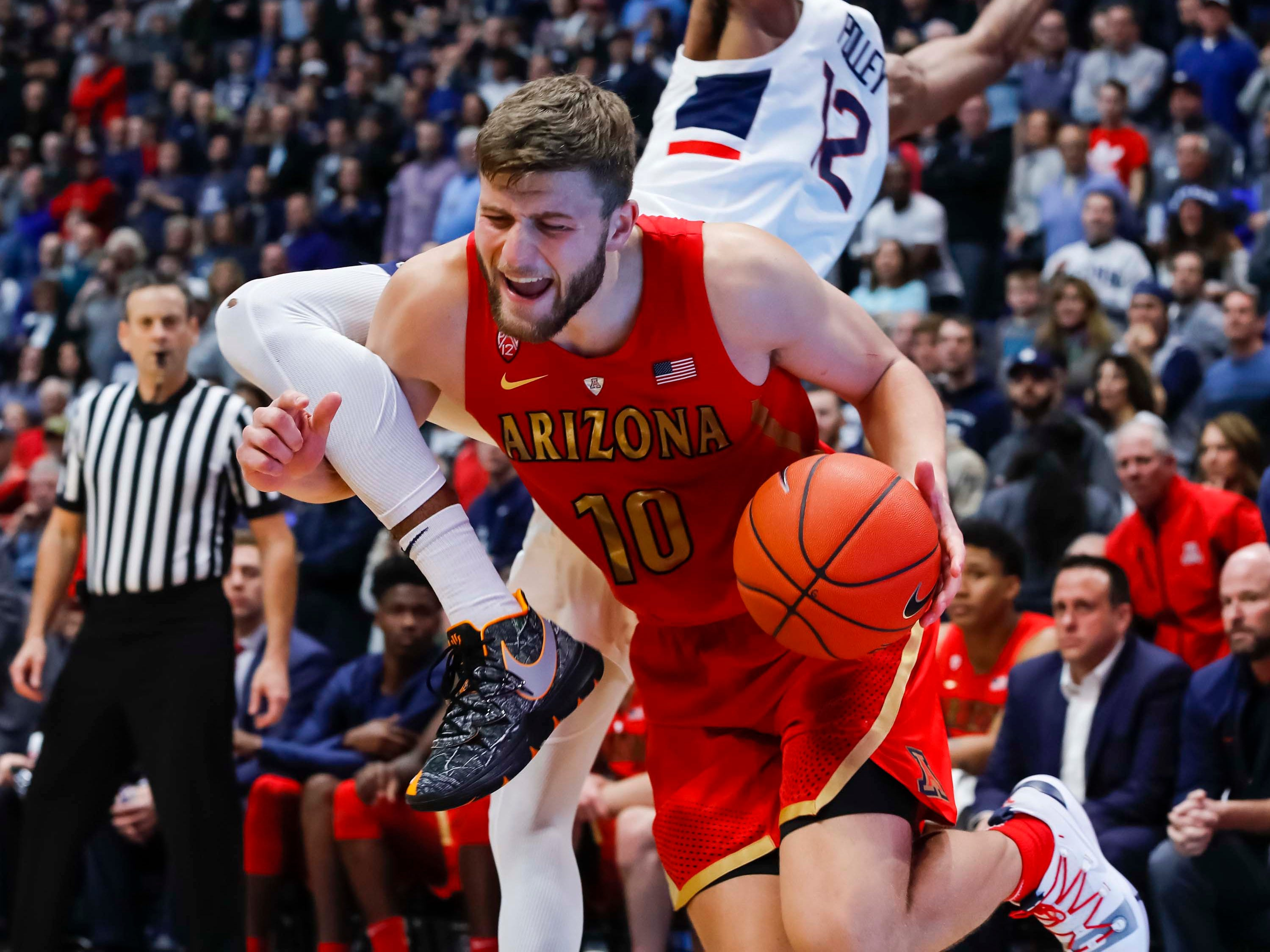 Dec 2, 2018; Storrs, CT, USA; Connecticut Huskies forward Tyler Polley (12) fouls Arizona Wildcats forward Ryan Luther (10) in the second half at XL Center. Arizona defeated UConn 76-72. Mandatory Credit: David Butler II-USA TODAY Sports