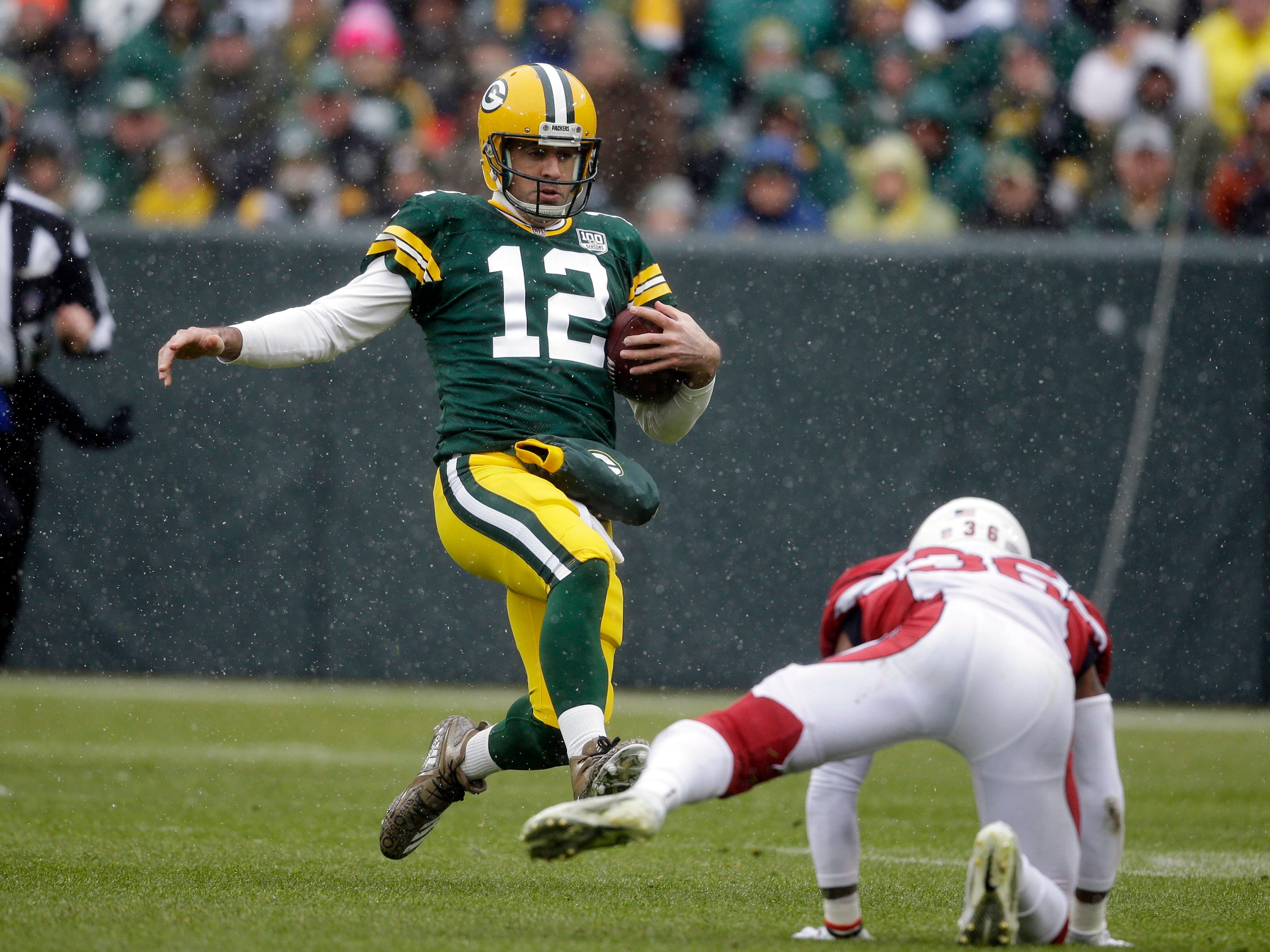 Green Bay Packers quarterback Aaron Rodgers slides to down the ball against the Arizona Cardinals during the first half of an NFL football game Sunday, Dec. 2, 2018, in Green Bay, Wis. (AP Photo/Jeffrey Phelps)