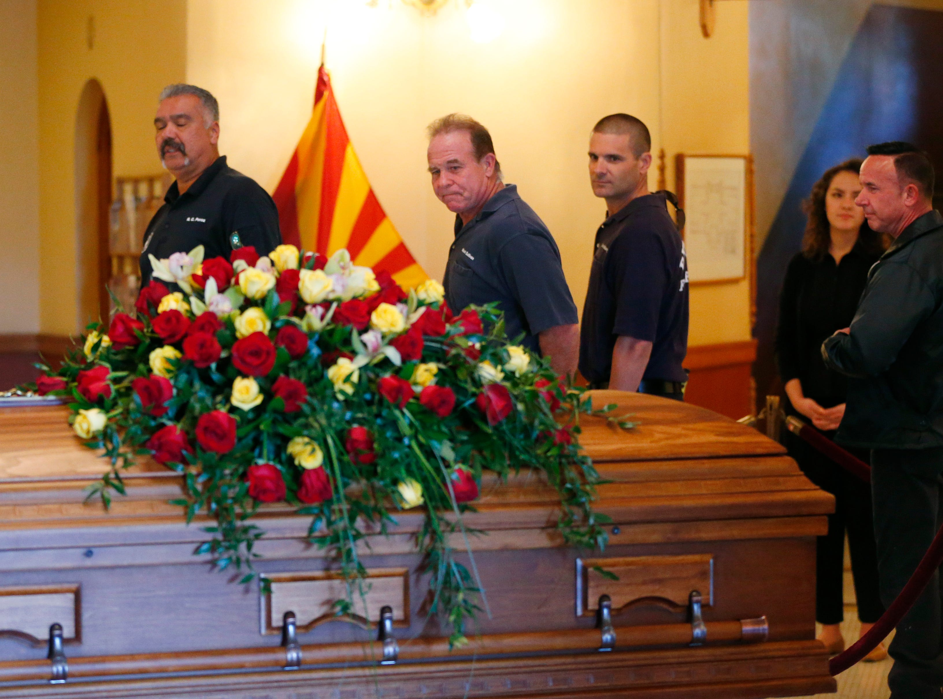 Phoenix firefighters pay their respect to former U.S. Rep. Ed Pastor as he lies in state at the Arizona Capitol, Dec. 2, 2018.