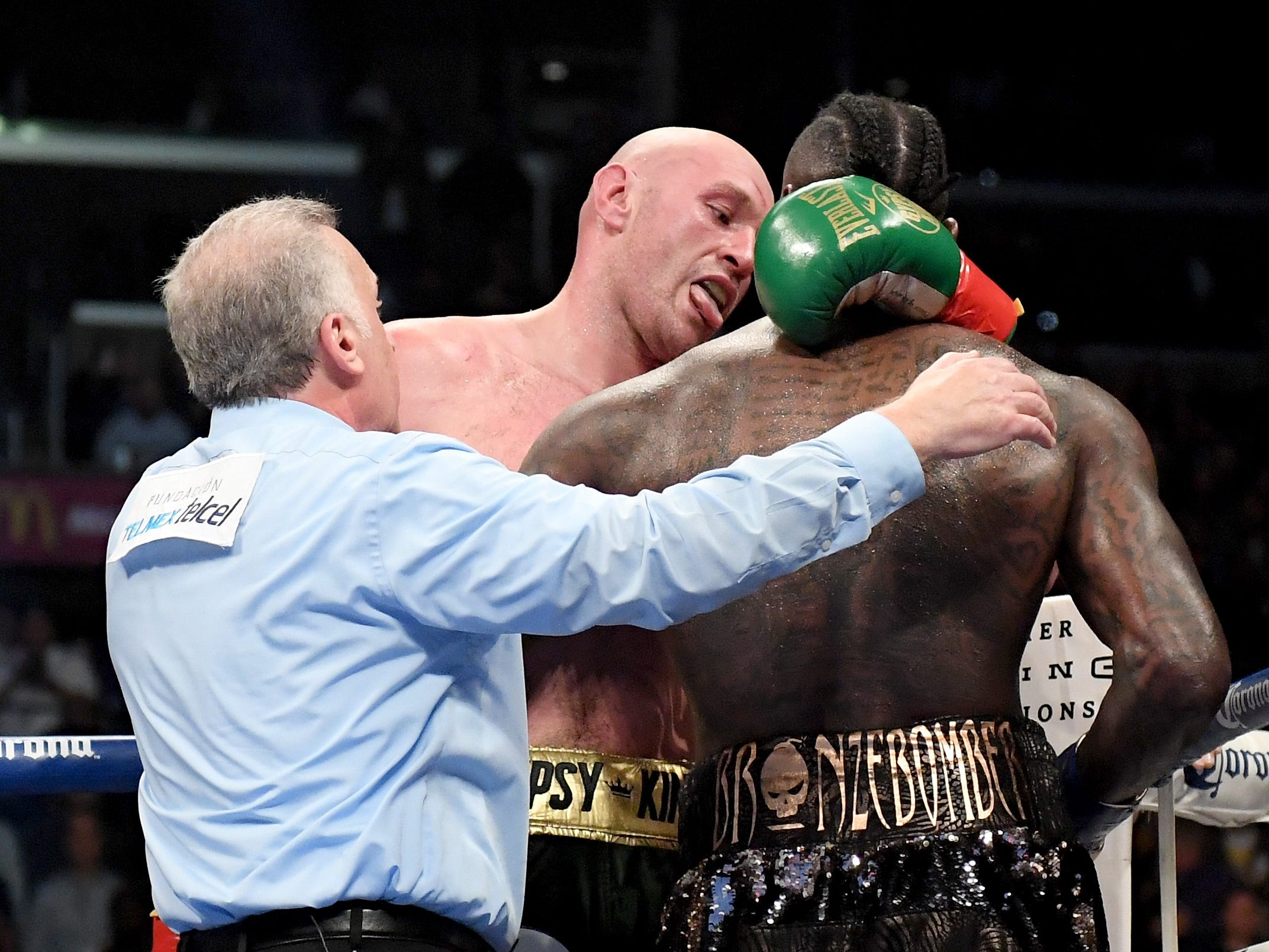 Tyson Fury faces Deontay Wilder at the end of the ninth round of their WBC heavyweight title fight Dec. 1 at Staples Center.