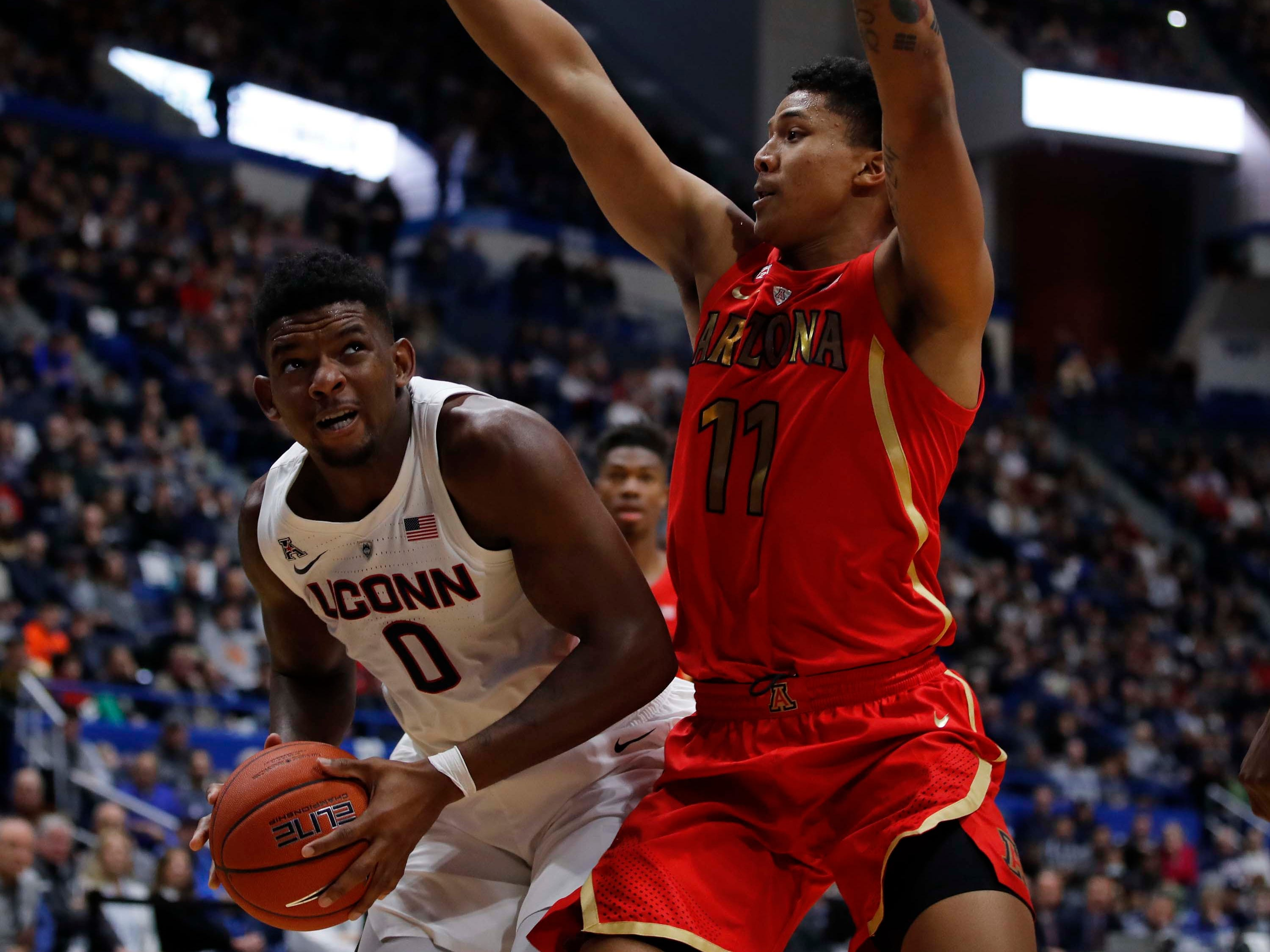 Dec 2, 2018: Connecticut Huskies forward Eric Cobb (0) looks to shoot against Arizona Wildcats forward Ira Lee (11) in the first half at XL Center.
