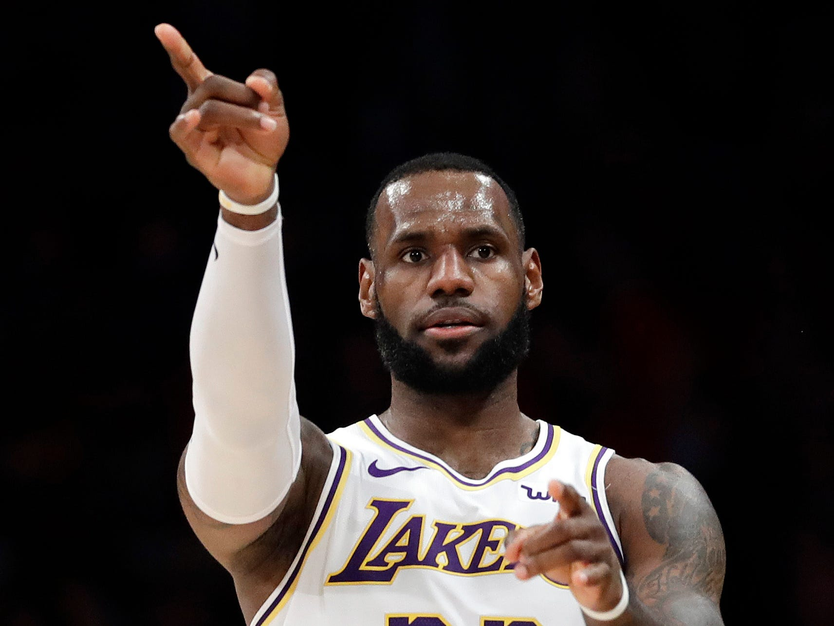 Los Angeles Lakers' LeBron James (23) gestures after scoring against the Phoenix Suns during the first half of an NBA basketball game Sunday, Dec. 2, 2018, in Los Angeles. (AP Photo/Marcio Jose Sanchez)