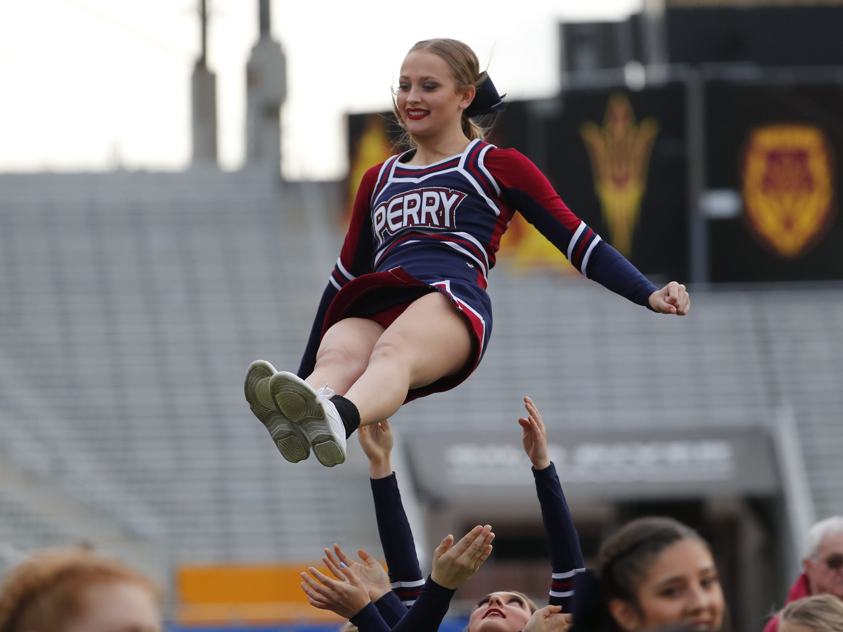 A Perry High cheerleader is tosses in the air during the 6A state football championship game against Chandler at Sun Devil Stadium December 1, 2018. #azhsfb
