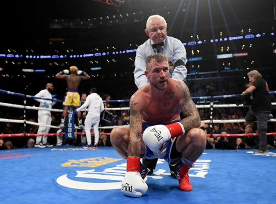 Jason Welborn reacts after getting knocked out in the fourth round of a fight against Jarrett Hurd on Dec. 1 at Staples Center.