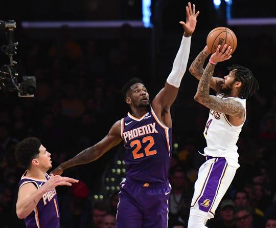 Lakers forward Brandon Ingram puts up a shot over Suns center Deandre Ayton during the second quarter at Staples Center.