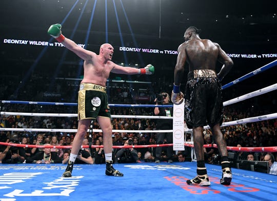 Tyson Fury taunts Deontay Wilder  during their WBC Heavyweight title fight Dec. 1 at Staples Center.
