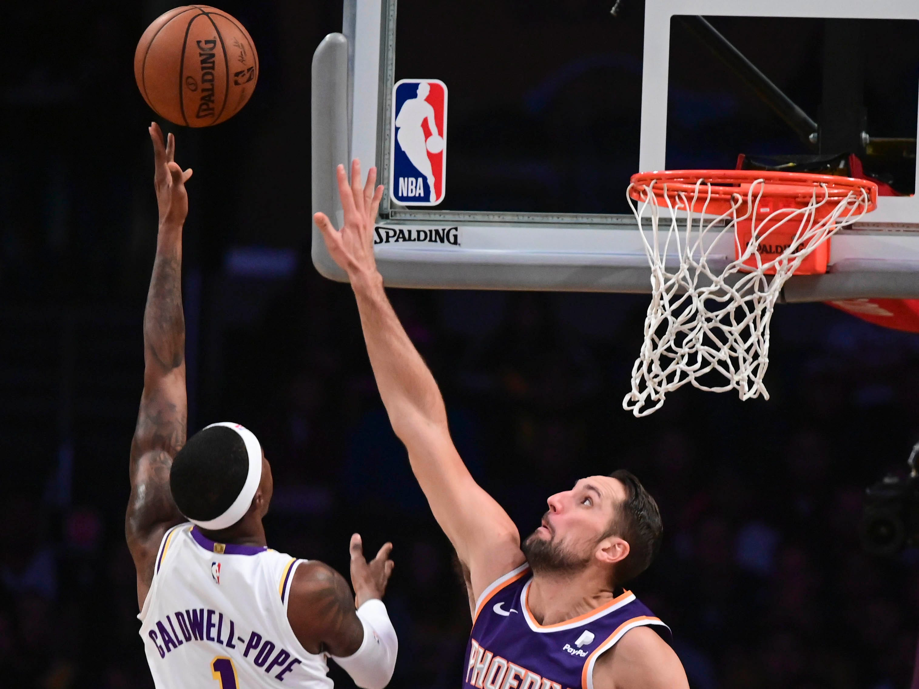 Dec 2, 2018; Los Angeles, CA, USA; Los Angeles Lakers guard Kentavious Caldwell-Pope (1) puts up a shot over Phoenix Suns forward Ryan Anderson (15) during the second quarter at Staples Center. Mandatory Credit: Robert Hanashiro-USA TODAY Sports