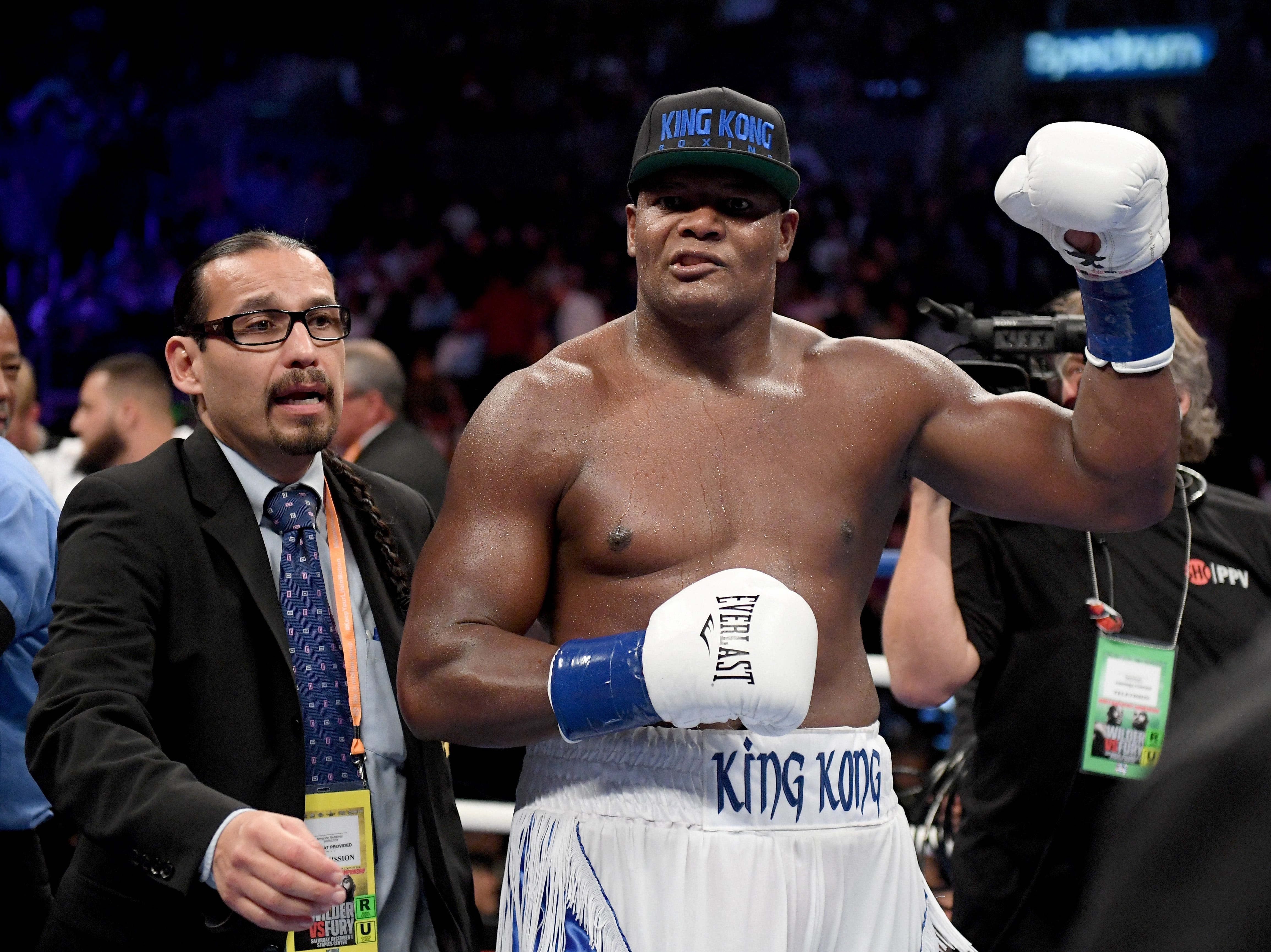 Luis Ortiz celebrates a 10th round TKO victory over Travis Kauffman during a heavyweight bout Dec. 1 at Staples Center.