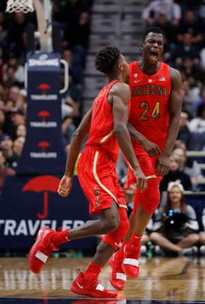 Dec 2, 2018: Arizona Wildcats guard Emmanuel Akot (24) and guard Brandon Randolph (5) react after a play against the Connecticut Huskies in the first half at XL Center.