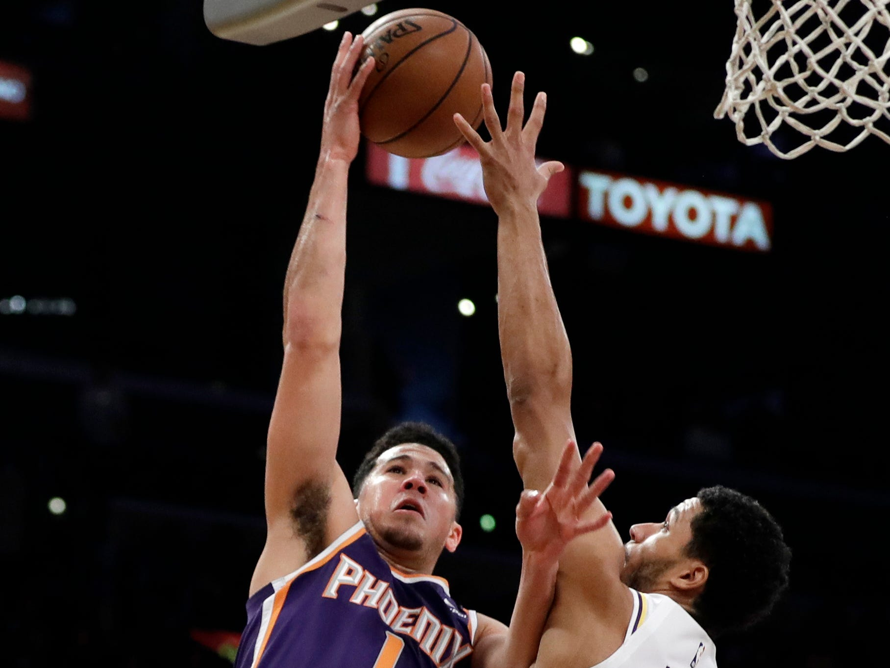 Phoenix Suns' Devin Booker (1) shoots over Los Angeles Lakers' Josh Hart (3) during the first half of an NBA basketball game Sunday, Dec. 2, 2018, in Los Angeles. (AP Photo/Marcio Jose Sanchez)