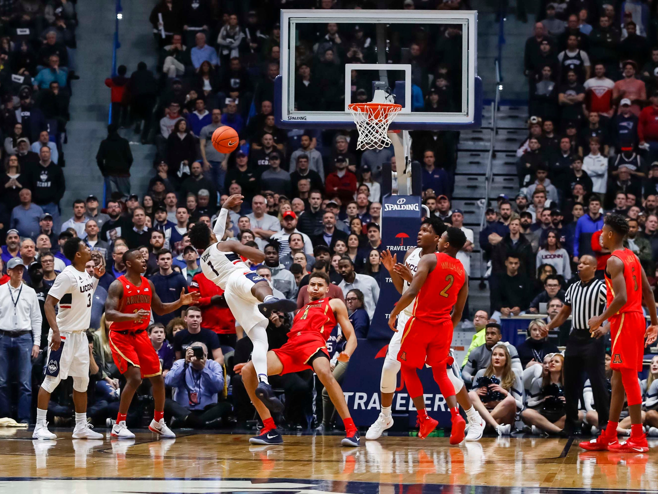Dec 2, 2018; Storrs, CT, USA; Arizona Wildcats forward Ira Lee (11) fouls Connecticut Huskies guard Christian Vital (1) in the second half at XL Center. Arizona defeated UConn 76-72. Mandatory Credit: David Butler II-USA TODAY Sports