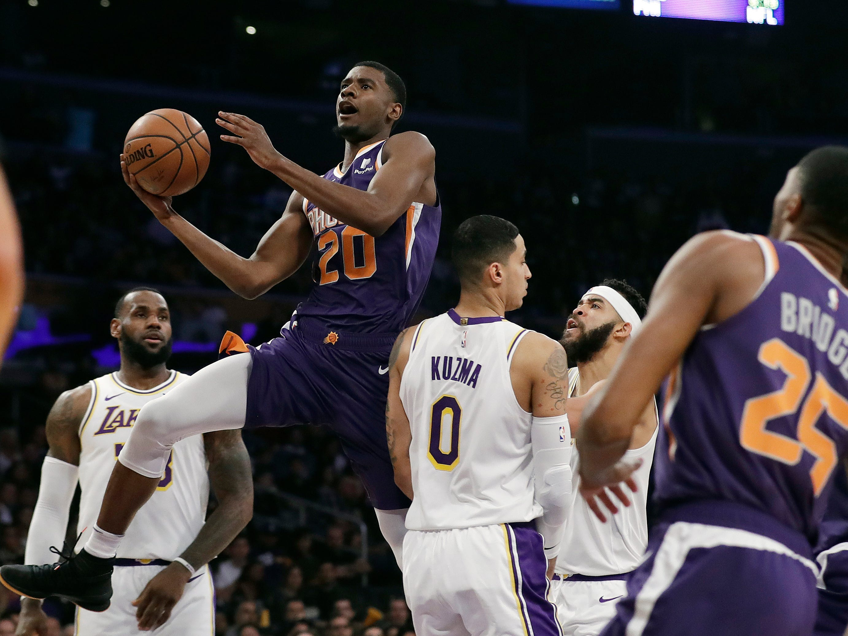 Phoenix Suns' Josh Jackson (20) shoots past Los Angeles Lakers' Kyle Kuzma (0) during the first half of an NBA basketball game Sunday, Dec. 2, 2018, in Los Angeles. (AP Photo/Marcio Jose Sanchez)