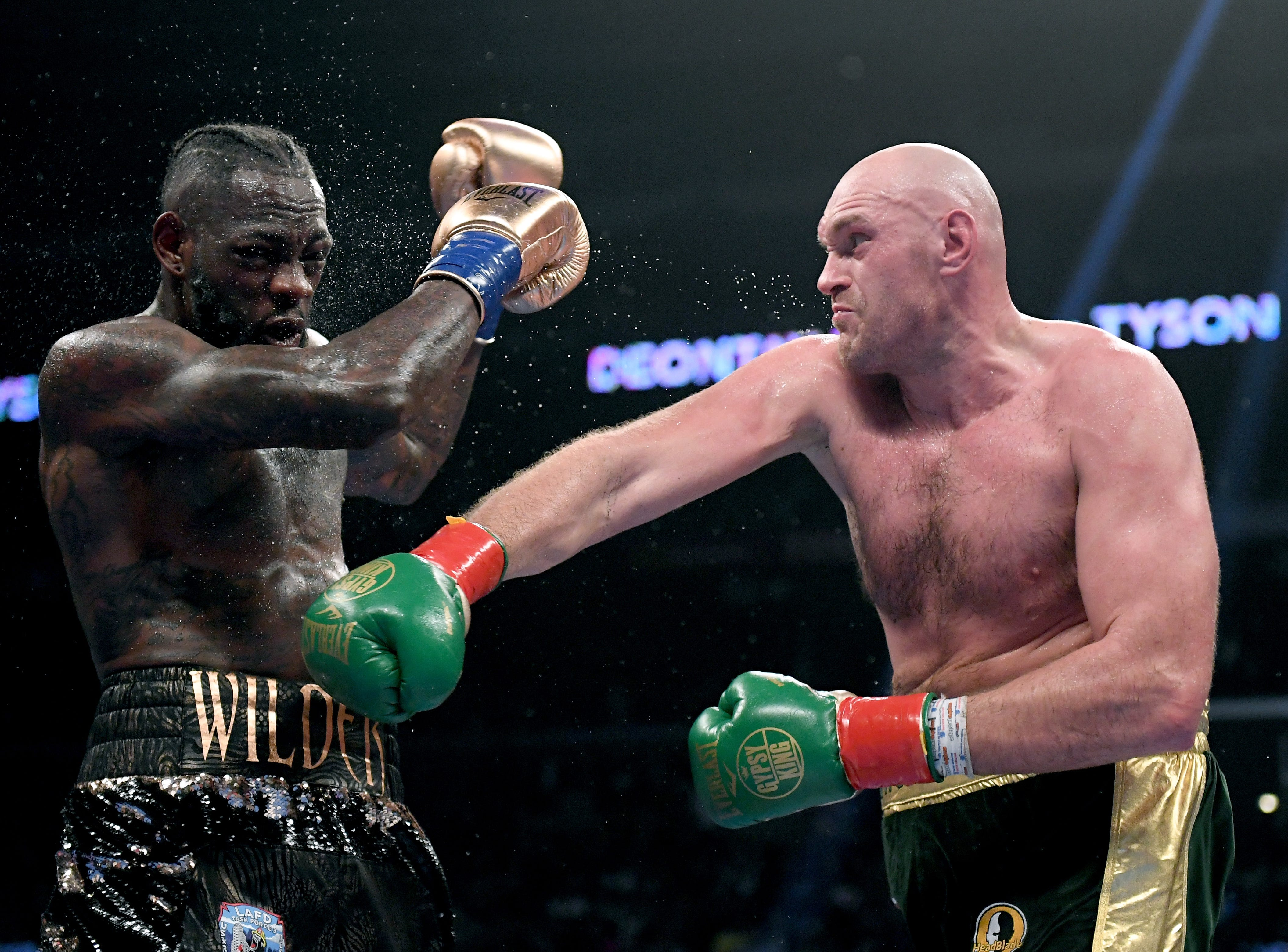 Tyson Fury hits Deontay Wilder with a right hand during the seventh round of their Dec. 1 WBC heavyweight title fight at Staples Center.