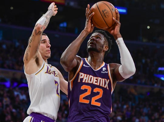 Suns center Deandre Ayton looks to the basket as he's defended by Lonzo Ball during the second quarter of a game Dec. 2 at Staples Center.