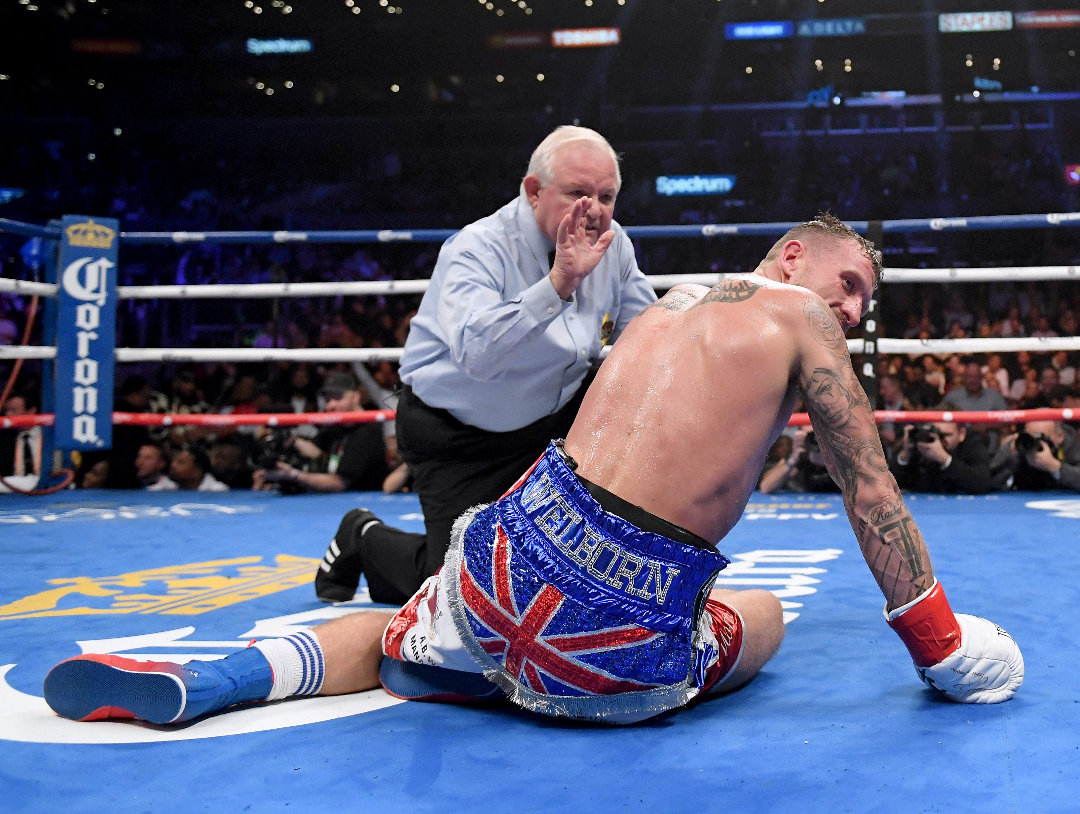 Jason Welborn is counted out during the fourth round of his WBA-IBF-IBO junior-middleweight title fight against Jarrett Hurd on Dec. 1 at Staples Center.